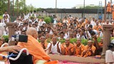 Sadhus and youths doing darshan of Swamishri