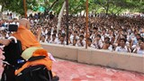 Students doing darshan of Swamishri