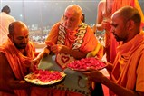 Swamishri sanctifies yantras to be places beneath the murtis