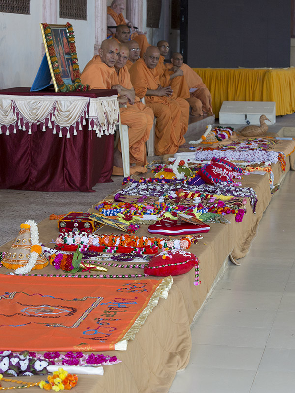 Garlands and shawls prepared for offering to Thakorji