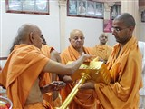 Pujya Mahant Swami performs pujan of kalashas and flagstaffs to be installed on  the Guru Parampara shrines at Shri Yagnapurush Smruti Mandir, Sarangpur