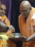 Swamishri sanctifies dudhpak to be served to all for Shastriji Maharaj's smrutiparva the next day