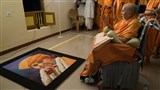 Swamishri observes a rangoli - a portrait made with colored powder