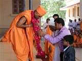 The father and brother garland the newly initiated sadhu as part of the diksha rituals culmination
