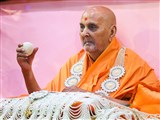 Swamishri honored with garland and a  shawl