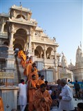 Sadhus and devotees wish each other after Arti