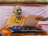 Swamishri sanctifies s diwali card