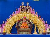 Swamishri's murti on stage