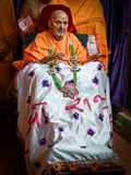 Swamishri is honored with garland and a shawl