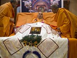 Swamishri is honored with a shawl and garland