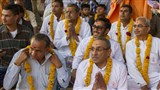 Fathers of the newly initiated sadhus honored with garlands