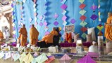 Swamishri on the stage decorated for Jholi Utsav and Uttarayan