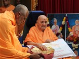 Swamishri sanctifies yantras to placed beneath the murtis at Mahuva Mandir