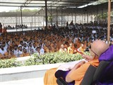 Sadhus and devotees engaged in darshan of Swamishri
