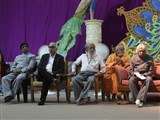 Dignitaries on the stage during an assembly