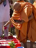 Pujya Tyagvallabh Swami showers sanctified flower petals on prasad boxes