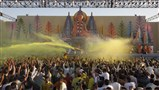 Swamishri showers sanctified colored water on devotees and blesses them