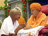 Swamishri gives diksha mantra to newly initiated parshads and blesses them