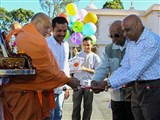 Pujya Ishwarcharan Swami and devotees inaugurate the play area for children