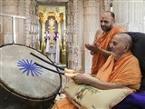 Swamishri plays the nagara in front of Shri Ghanshyam Maharaj