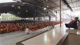 Sadhus and devotees doing darshan of Swamishri on Guru Purnima