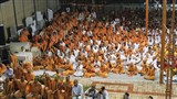 Sadhus and devotees doing darshan of Swamishri in the evening