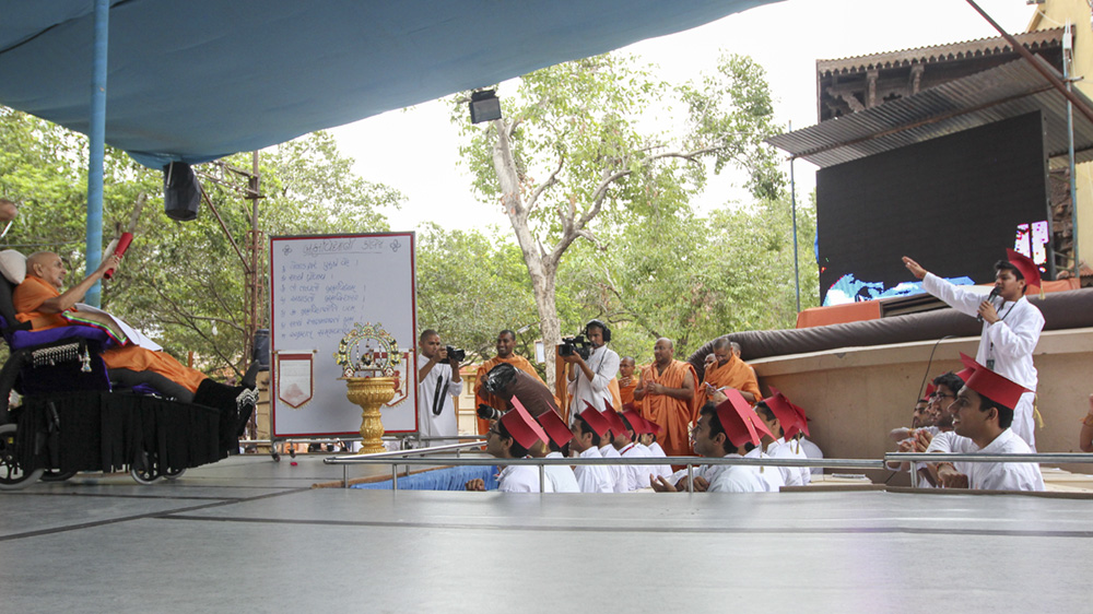 One of the youths makes a presentation before Swamishri