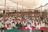A large gathering of devotees in the assembly