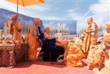 Pujya Mahant Swami pours cement at the pratishtha location of Bhagwan Swaminarayan