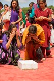 Devotees touch the stone sanctified by Swamishri