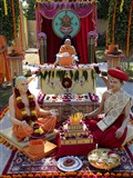 HH Pramukh Swami Maharaj performs his morning puja in front of tableau depicting the bhagwati diksha of Aksharbrahman Gunatitanand Swami, on the auspicious day of Poshi Punam