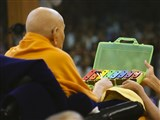 Swamishri plays a xylophone