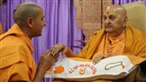 Swamishri gives diksha mantra to newly initiated sadhus