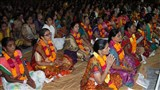Mothers of the newly initiated sadhus are honored with garlands