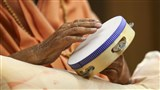 Swamishri plays musical instruments