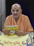 "Swamishri inaugurates an English print publication, ""Story Time"", for children"