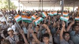 Students wave Indian tricolor flag