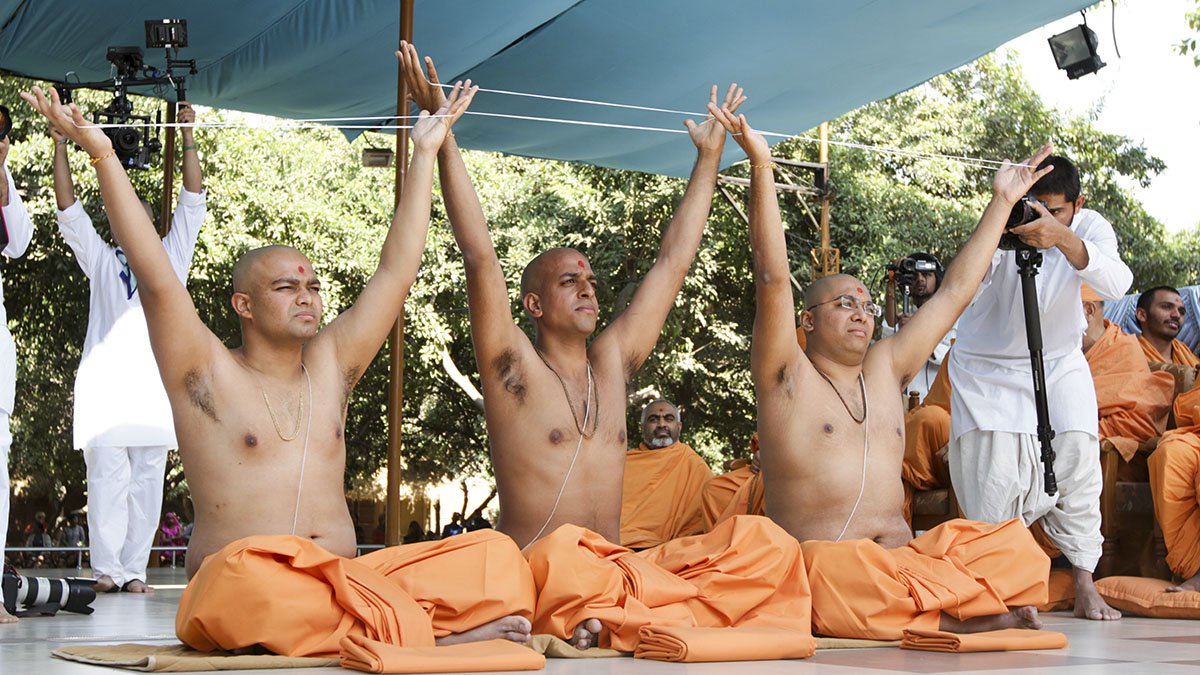 Three newly initiated sadhus participate in diksha ceremony