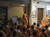Swamishri blesses sadhus studying Sanskrit, in the evening