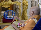 Swamishri swings Shri Harikrishna Maharaj in a decorative hindolo