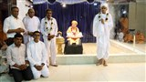 Newly initiated parshad with Swamishri