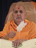 Swamishri with a flower chhadi