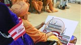 Swamishri inaugurates the logo for the Sarangpur Mandir Shatabdi Mahotsav
