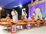 Youths and children enact glimpses of activities to be performed over the next year, as part of the Sarangpur Mandir Shatabdi Mahotsav - Parayan, reading from and explaining the scriptures