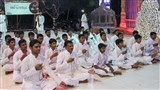 Youths enact glimpses of activities to be performed over the next year, as part of the Sarangpur Mandir Shatabdi Mahotsav - Bhaktiyagna, performing more malas and chanting Bhagwan Swaminarayan's name
