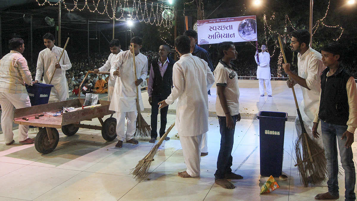 Youths enact glimpses of activities to be performed over the next year, as part of the Sarangpur Mandir Shatabdi Mahotsav - Swachchta Abhiyan, keeping our surroundings clean and helping create awareness of its benefits