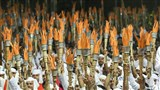 Youths of the Yuva Talim Kendra hold aloft torches as a symbol of their dedication