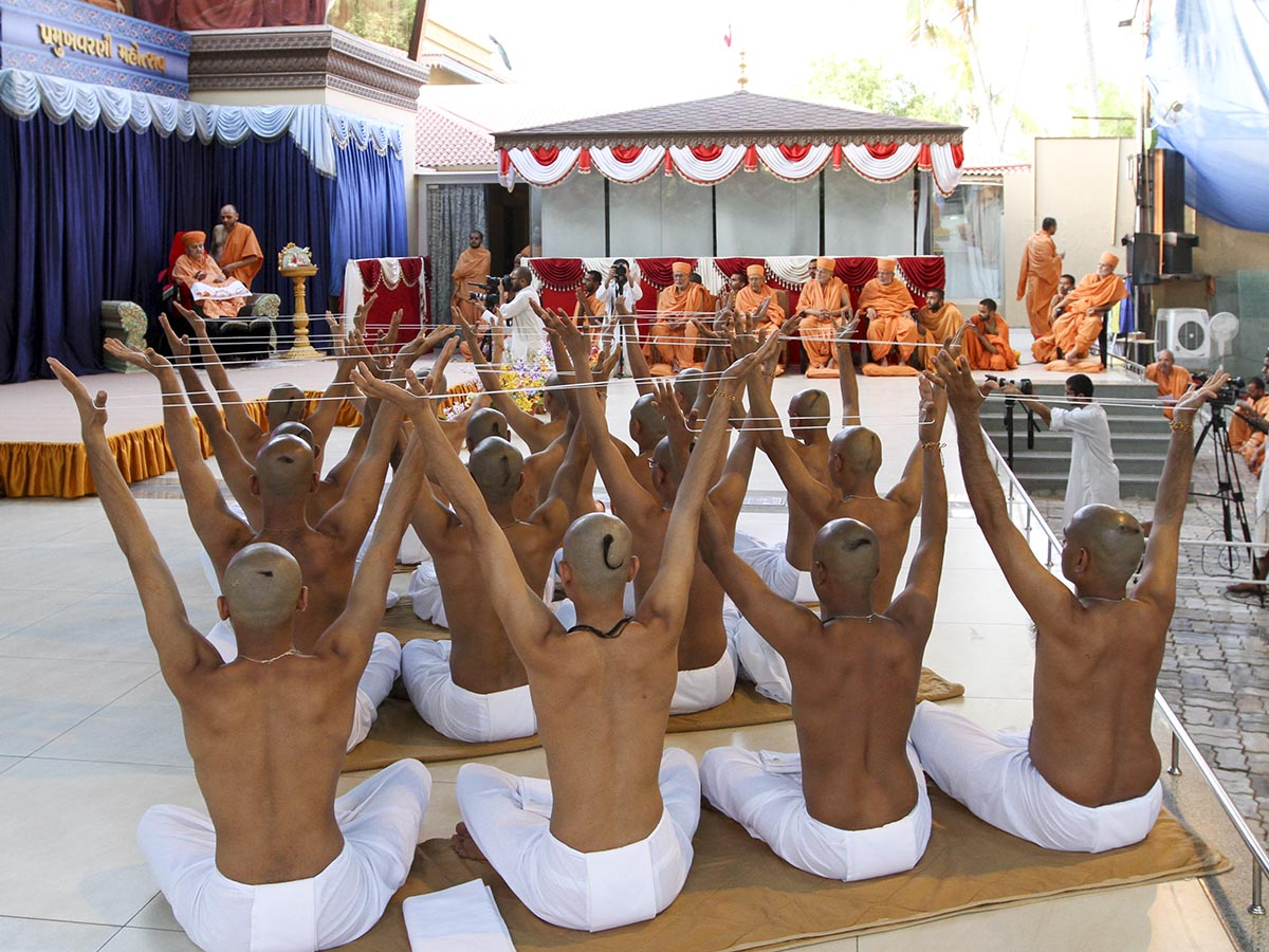 Newly initiated parshads participate in diksha ceremony