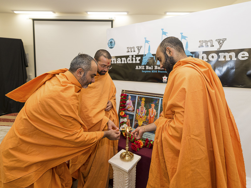 Sadhus lighting the inaugural lamp for Bal-Balika Shibir, Melbourne