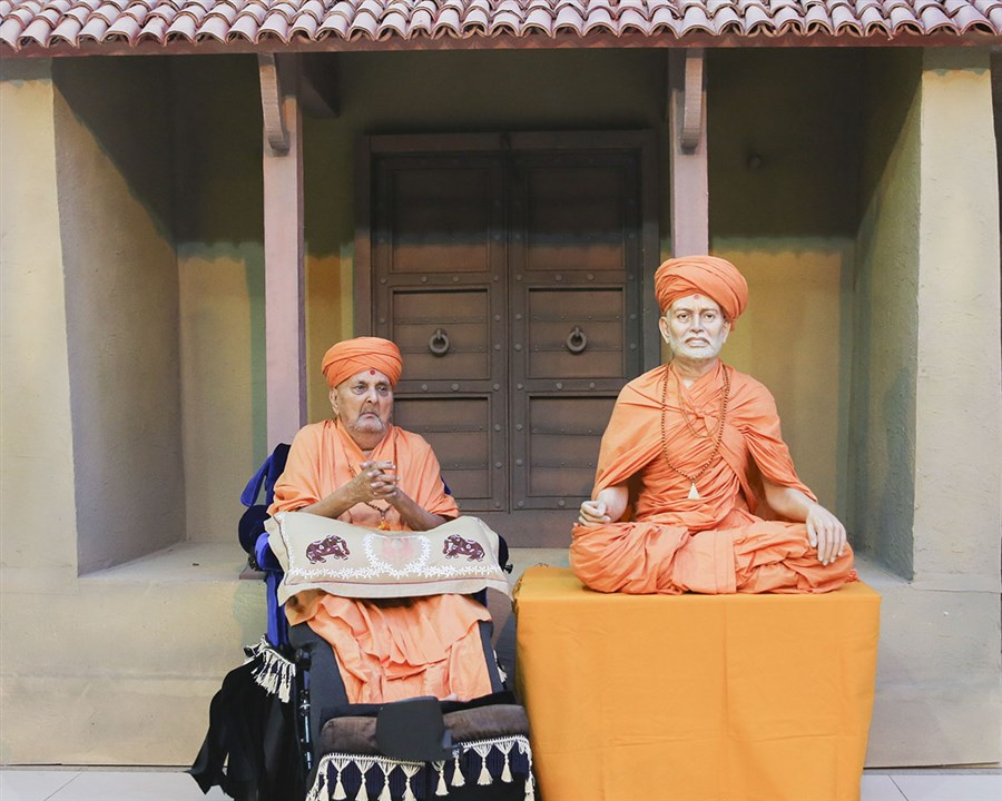 Swamishri folds his hands in a re-creation of his photograph with guru Shastriji Maharaj in Sarangpur. When the original photo was taken Shastriji Maharaj had instructed him to keep his hands folded with humility – which he continues to do, even 75 years later.